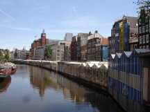 The flower market. Nurseries (and tourist shops) floating on barges in Amsterdam.