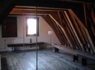 The final attic at the top, where the ropes are for hauling goods outside up to the higher levels.